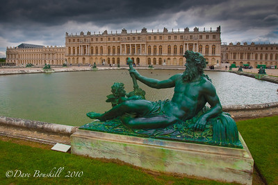 Statue guards the Palace of Versailles, France