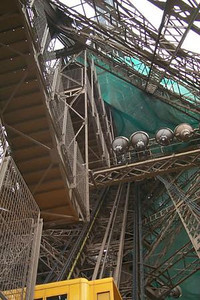 Looking up the steel structure at the Eiffel Tower - Paris, France