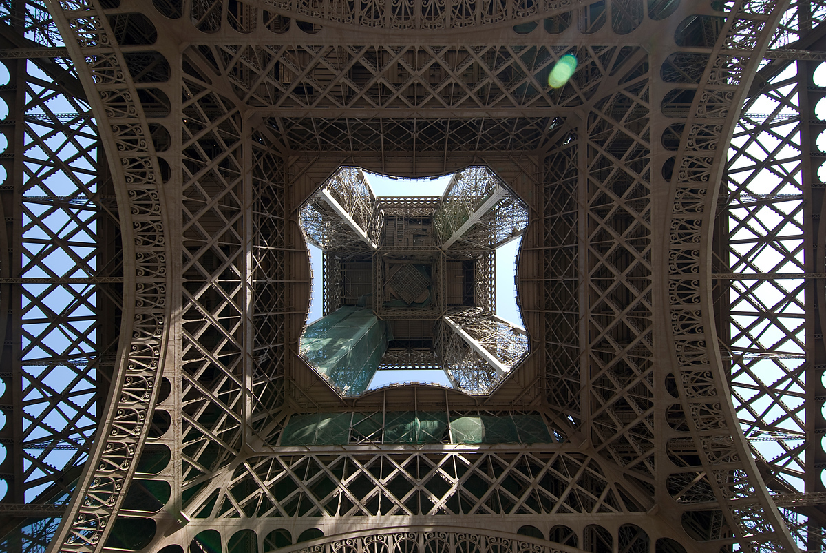 Looking up the skirt of the Eiffel Tower, Paris, France