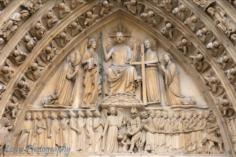 """Detail on door of <a target=""""NEWWIN"""" href=""""http://en.wikipedia.org/wiki/Notre_Dame_de_Paris"""">Notre Dame de Paris</a>, Paris, France"""