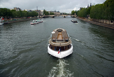 Tourist boat cruising the Seine River - Paris, France