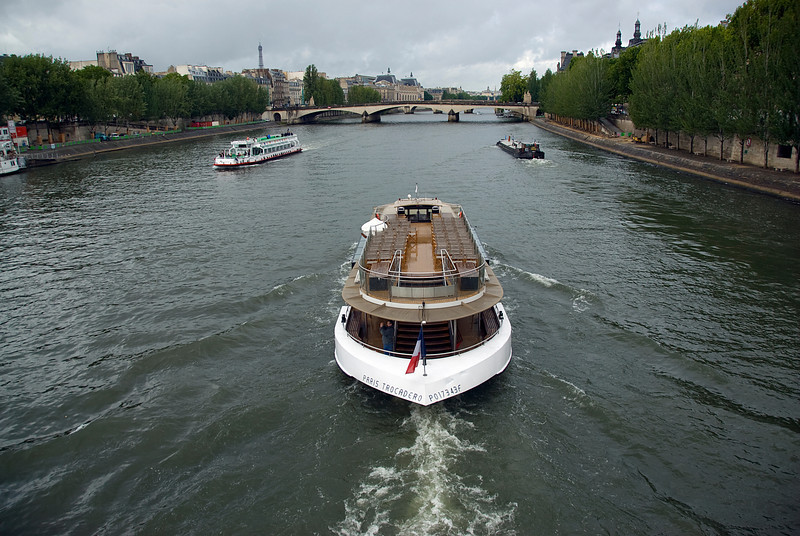 Tourist boat cruising the Seine River - Paris, France