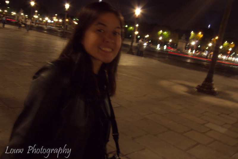 Catie on the streets of Paris at night, Paris, France