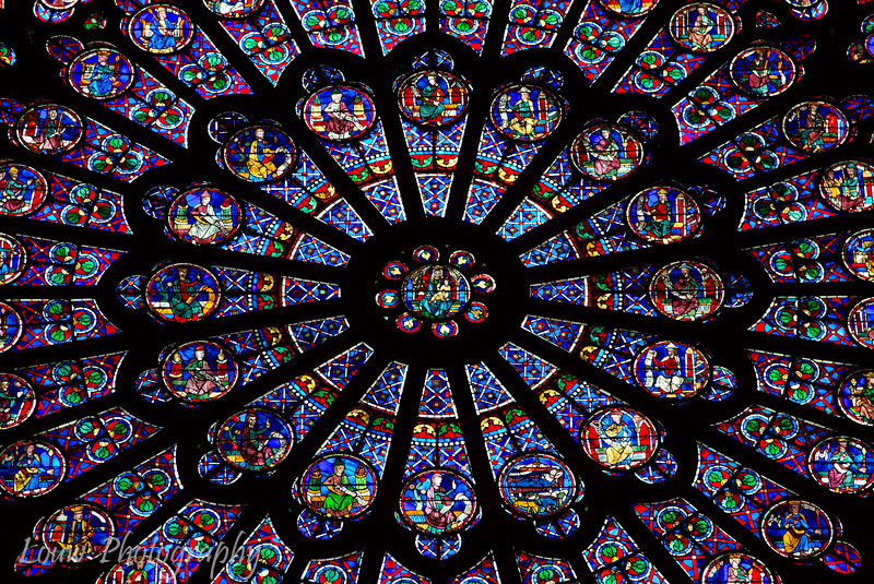"Detail shot of stained glass window, <a target=""NEWWIN"" href=""http://en.wikipedia.org/wiki/Notre_Dame_de_Paris"">Notre Dame de Paris</a>, Paris, France"