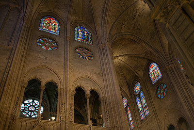Looking up the ceiling and stained glass windows of Notre Dame - Paris, France