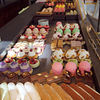 "Inside <a target=""NEWWIN"" href=""http://en.wikipedia.org/wiki/Ladur%C3%A9e"">Ladurée</a>, which sells the best <a target=""NEWWIN"" href=""http://en.wikipedia.org/wiki/Macaron"">macarons</a> in Paris!"