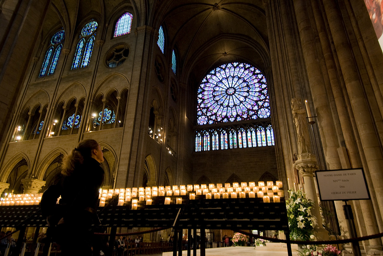 Candles lit inside the Notre Dame of Paris in France