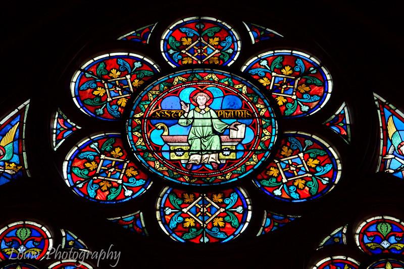 """Stained glass window, <a target=""""NEWWIN"""" href=""""http://en.wikipedia.org/wiki/Notre_Dame_de_Paris"""">Notre Dame de Paris</a>, Paris, France"""