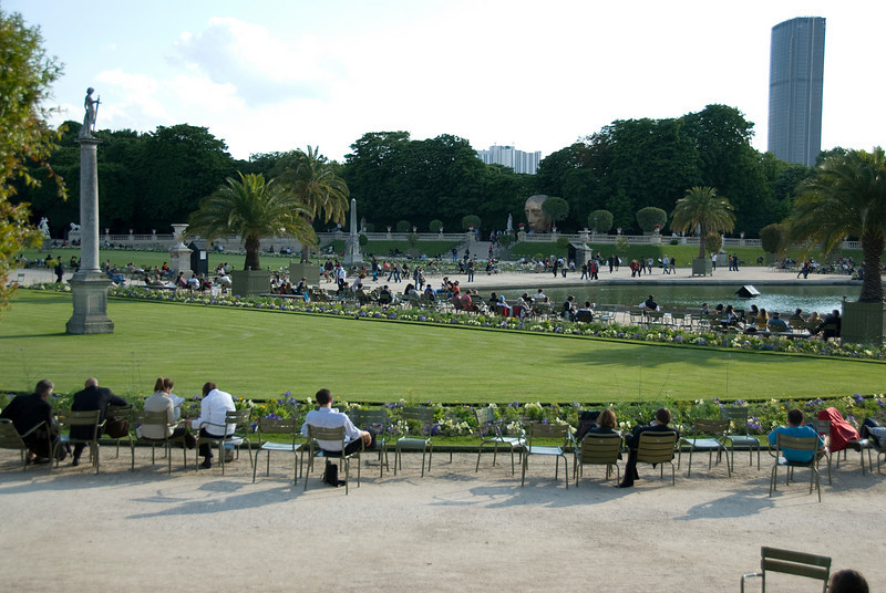 Tourists spending idle time in Park around Luxembourg Palace - Paris, France