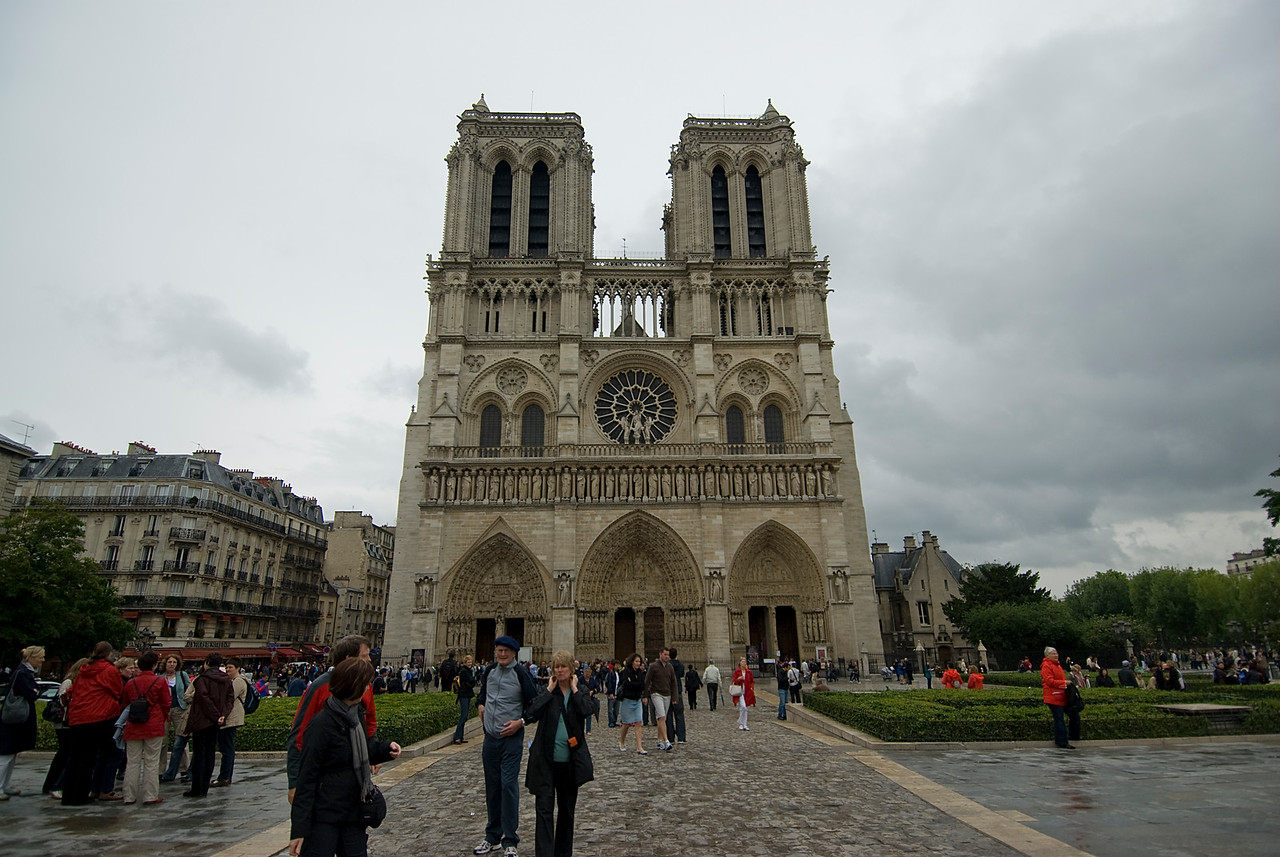 Tourists and locals outside the Notre Dame of Paris - France