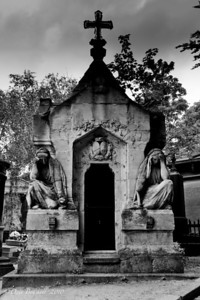 Women grieve at the Pere-La-Chaise Cemetery in Paris, France