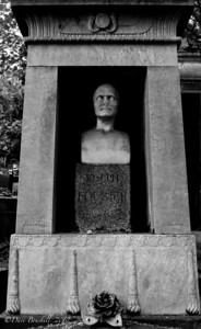 Creepy headstone at Pere-La-Chaise Cemetery in Paris, France