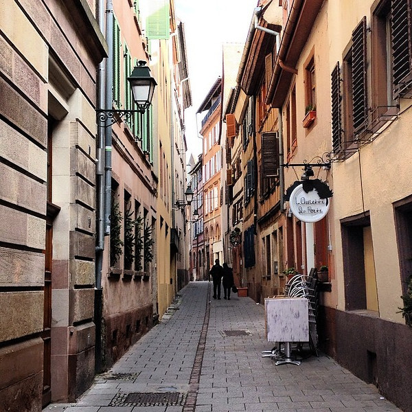Just wrote about all the bits you won't find on an itinerary, but you shouldn't miss: signs, lanterns, shutters, and lonely figures down a narrow cobble-way. This is Strasbourg, France. This is #Europe via Instagram http://ift.tt/1eEeTgc
