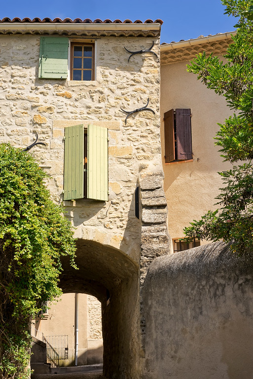 quaint french house with green shutters in chateau d'ansoius in provence france