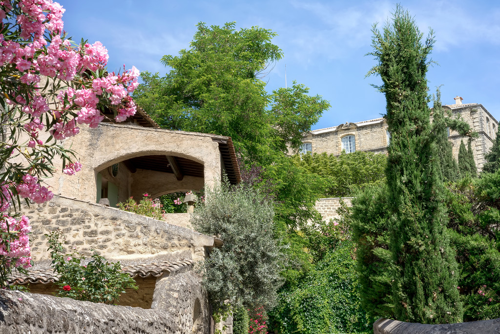 old provence buildings with flowers and foliage in chateau d'ansouis
