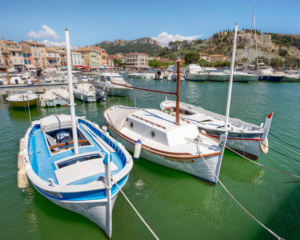 three traditional boats tied up in the harbour of cassis france
