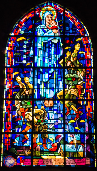 Stained Glass window in the Church of Ste. Mere Eglise Commemorating the Landing of Paratroopers in the Village on D-Day (©simon@myeclecticimages.com)