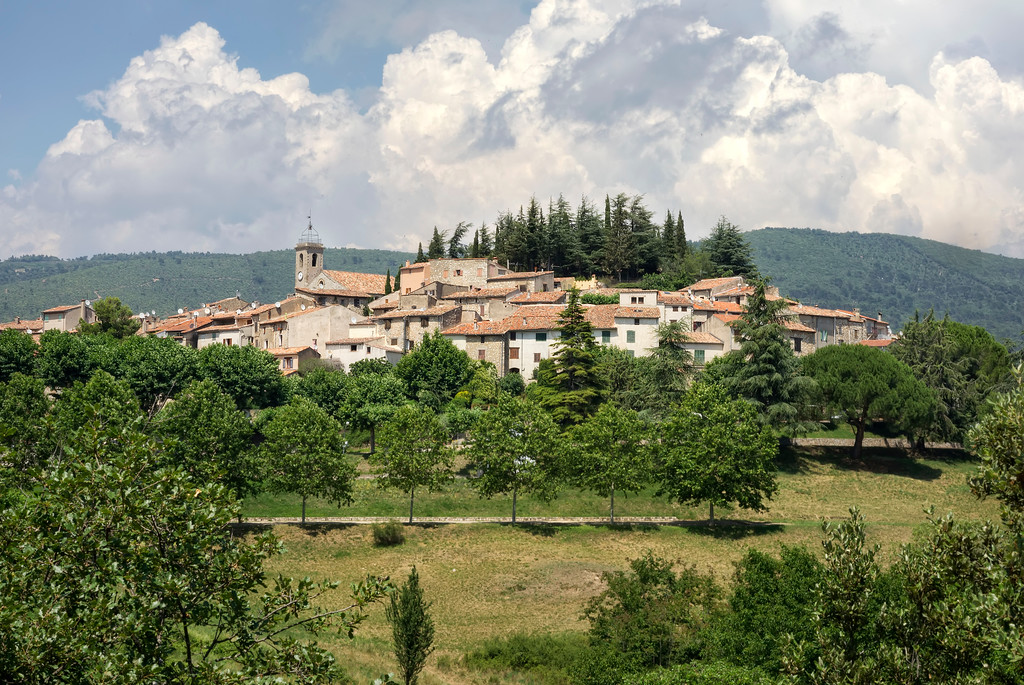 ampus small village surrounded by trees and mountains in french countryside