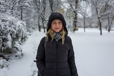 Blonde girl smiling in snowy landscape