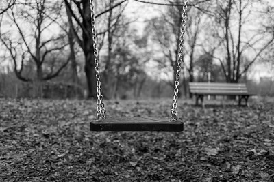 Empty swing on playground