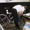 Mechanic inflates the tires on a Focus track bike.
