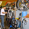 Mechanic works on Robert Bartko's bike,