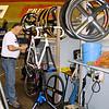 Mechanic works on Robert Bartko's bike,