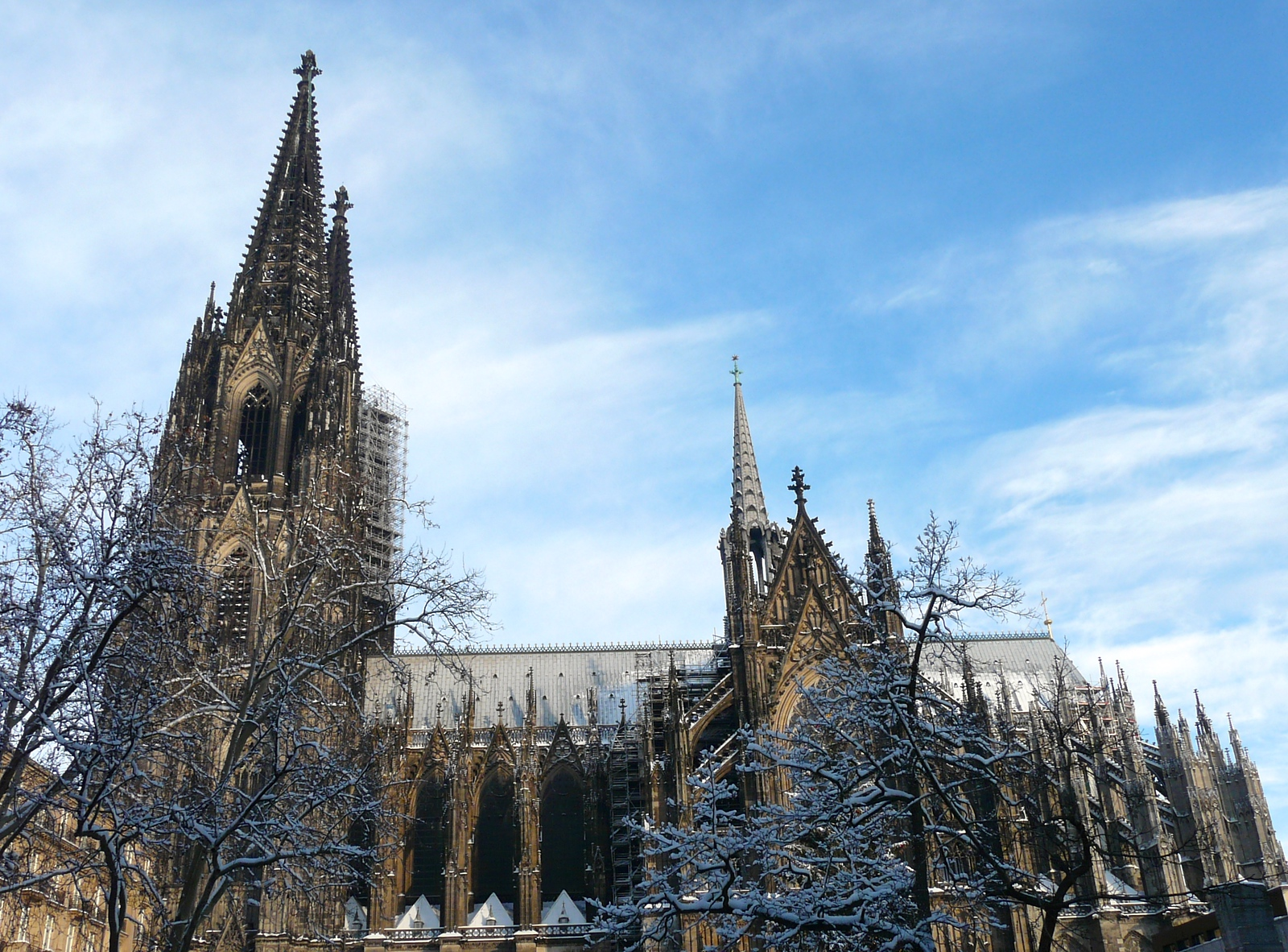 Spires of Cologne cathedral reach into a blue, winter sky