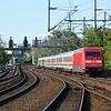101 001 propels it train away from Berlin Zoologischer Garten.
