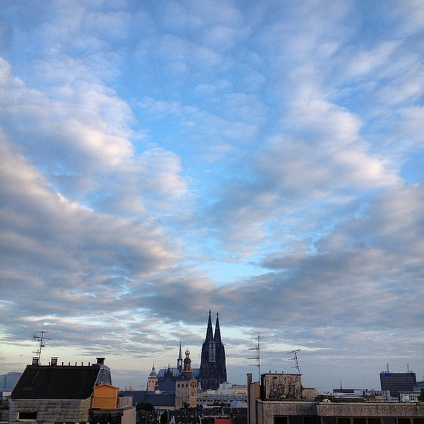 Cologne skyline, from Hansaring south to the Rhine. I spent the entire day trying to cram the spires of the massive Cologne Cathedral into the frame. Then I looked out our hotel window and found a way. Dear hotel security: that was not me and Audrey crawling out our window onto the hotel roof. #skyporn via Instagram http://ift.tt/W8aWh5