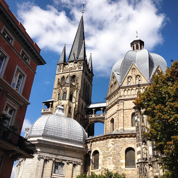 Back streets and little plazas in the shadow of the 1200  year-old Aachen Cathedral, touched with a fine dose of summer wind-down weather, puffy clouds included. #Germany #welterbegermany via Instagram http://ift.tt/W2nHKa