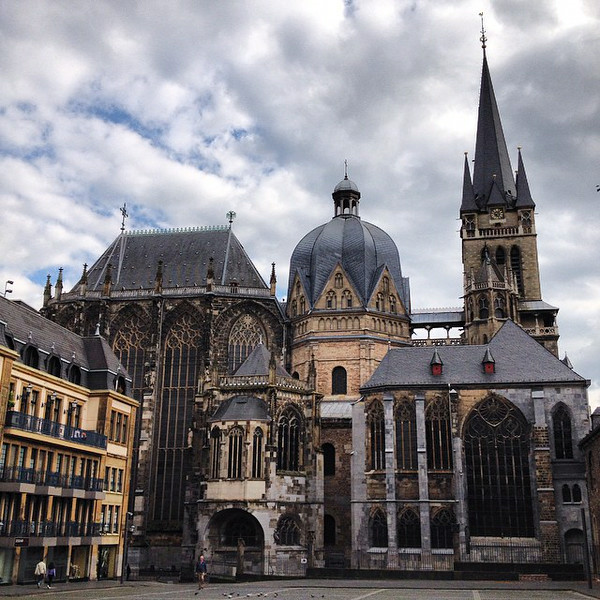 "A view of the Aachen Cathedral from the Katschhof. Because of its shape, the dome is affectionately referred to as ""the lemon juicer."" I wonder whether Charlemagne would approve. via Instagram http://ift.tt/1ns0OHx"