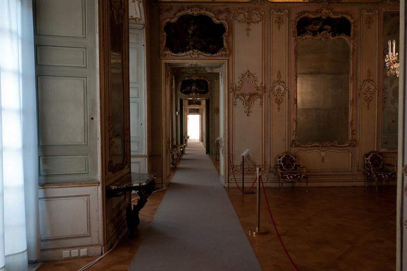 Long and narrow corridor inside the Augustusburg Palace - Germany