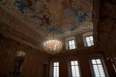 Colorful ceiling and large chandelier in a room at Augustusburg Palace - Germany