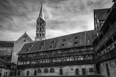 Tower of the Dom Cathedral peeking from behind a rooftop - Bamberg, Germany