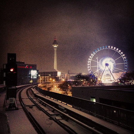 This is my movie. Train tracks, snow, ferris wheel, light bending at the Christmas market.