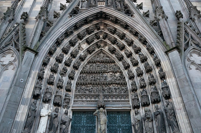 Architectural details on main entrance door to Cologne Cathedral - Germany