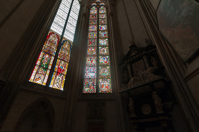 Tall stained-glass windows inside Cologne Cathedral in Germany