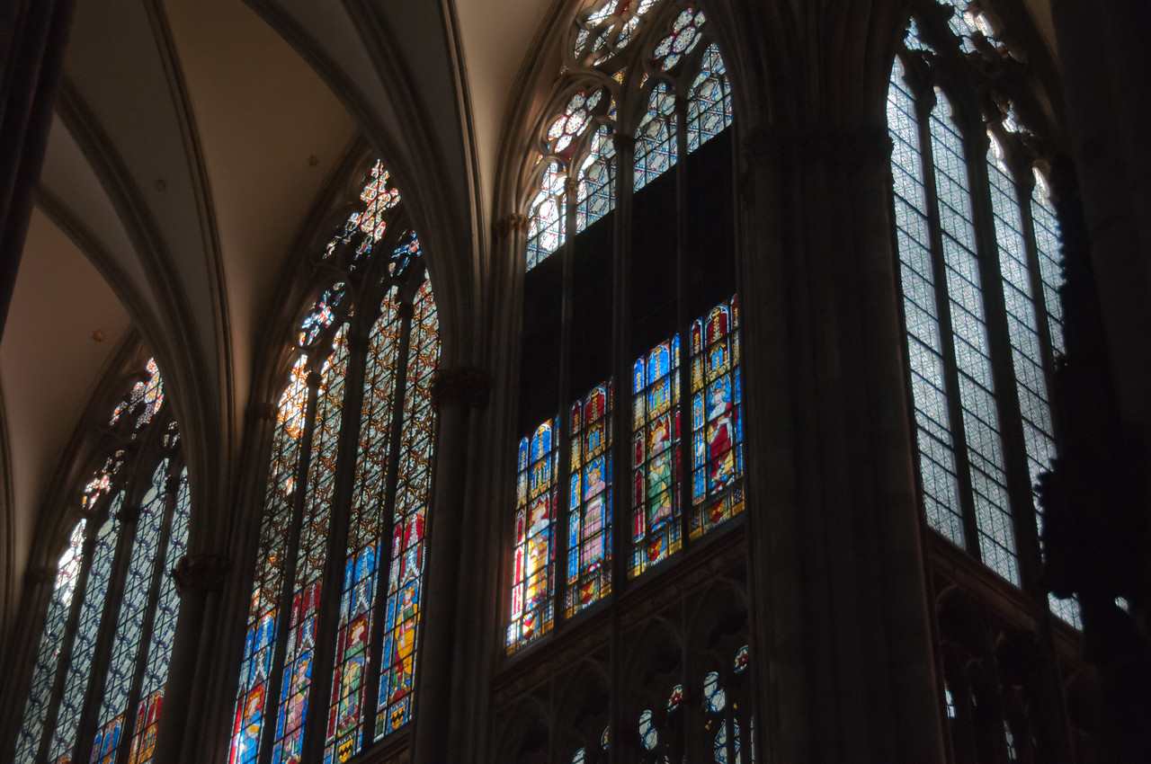 Tall glass-stained windows inside Cologne Cathedral - Germany