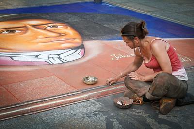 Street artist in action.
