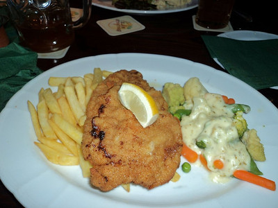 "Schnitzel Vienna-style with broccoli, french fries & small salad.  €13.50.  Served in ""Brauhaus Mitte"" in Berlin  13/05/13"