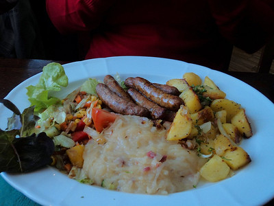 "Sausages Nürnberger-style with sauerkraut, fried potatoes & salad. €9.50.  Served in ""Brauhaus Mitte"" in Berlin.      14/05/13."