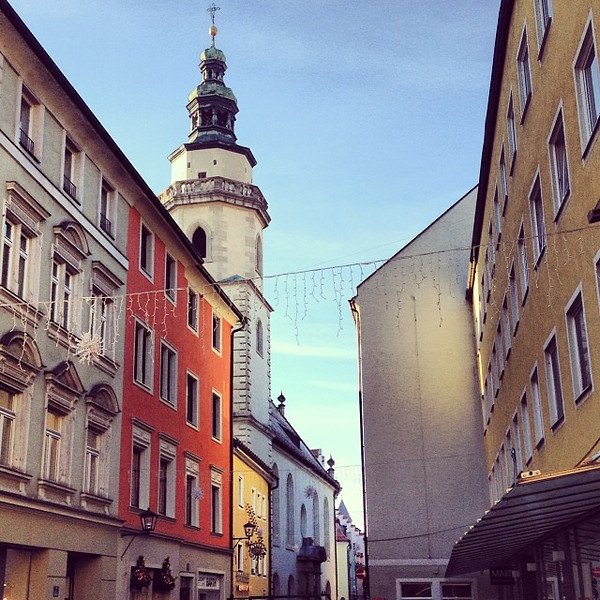 Poking around the back streets of Regensburg. Buildings like frosted cake, a wee string of Christmas lights. #Germany