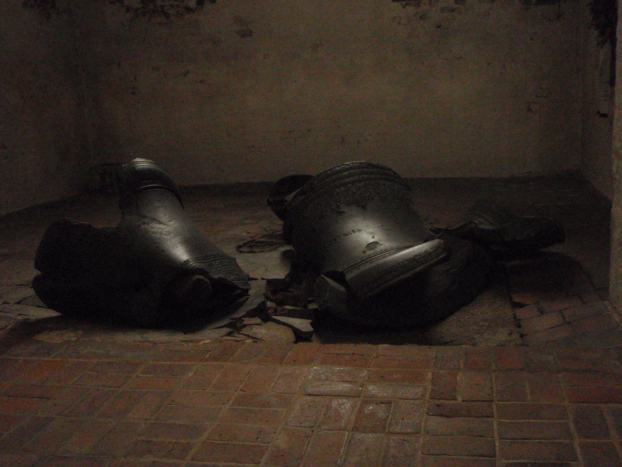 Bell's fallen to the floor in one of Lubeck's cathedrals.  The bells, which fell during World War II bombings, were left as a reminder of the horrors of war.