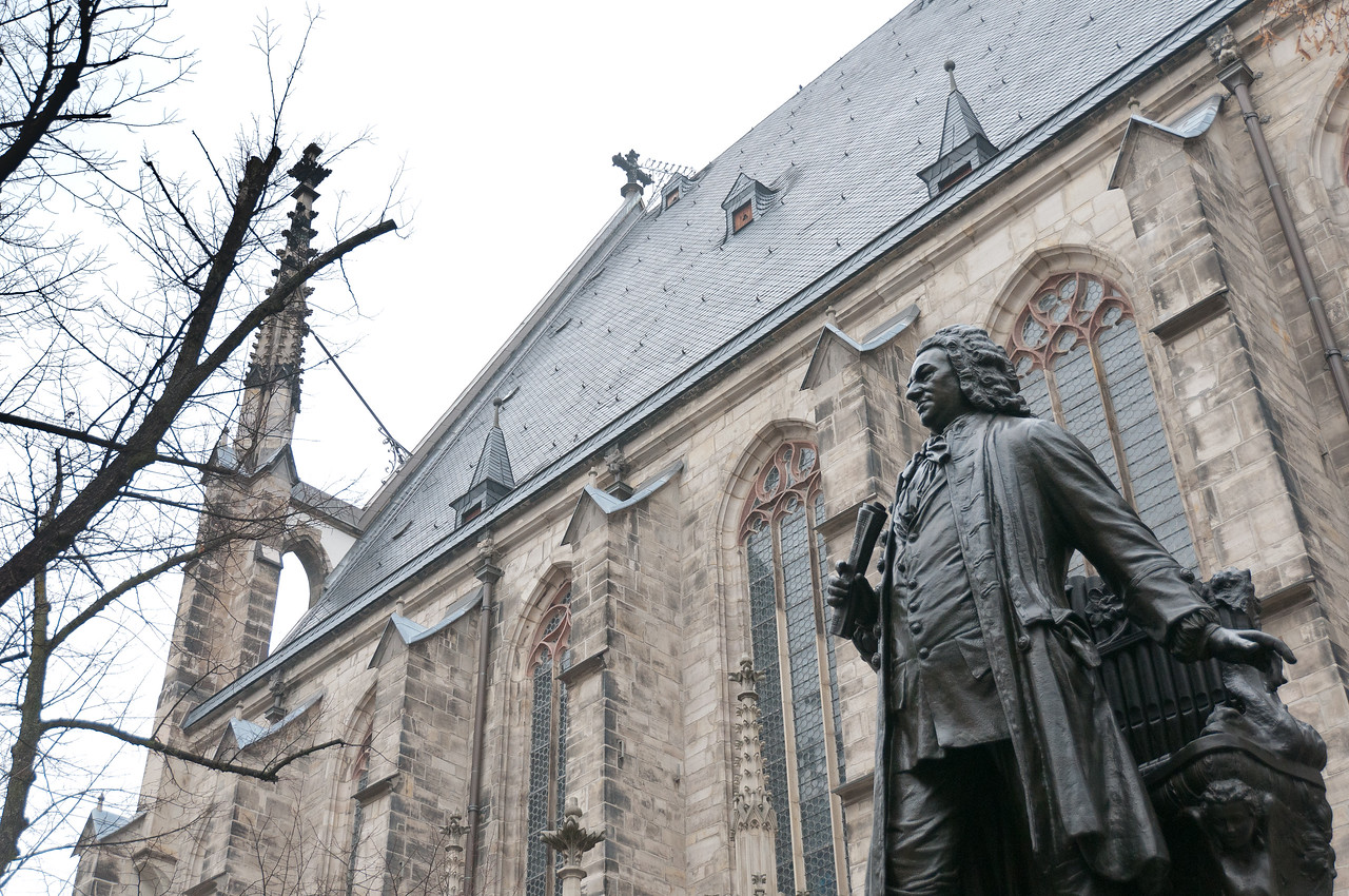 View of the Bach statue and St. Thomas Church in Leipzig, Germany