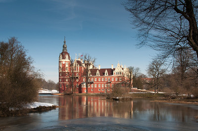 View of the New Castle from across the lake in Muskauer Park, Germany
