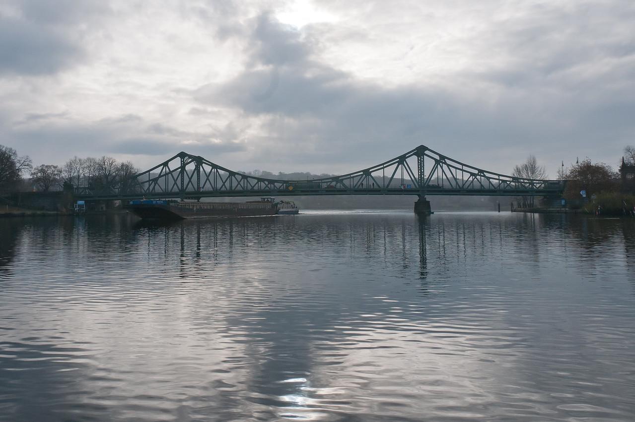 Wide shot of Glienicke Bridge and lake in Potsdam, Germany