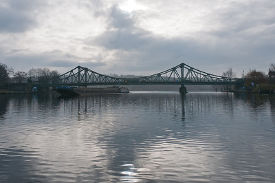 Wide shot of Glienicke Bridge and lake in Potsdam, Germany