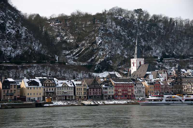 Closer shot of the houses and structures along river bank in Upper Middle Rhine Valley, Germany