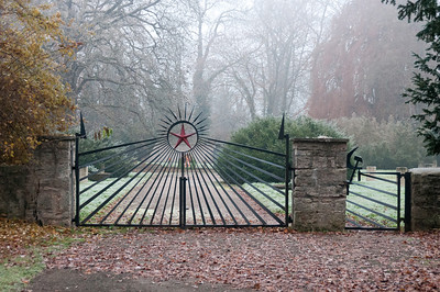 The Communist red star emblem and hammer and sickle symbol at gate to cemetery - Weimar, Germany